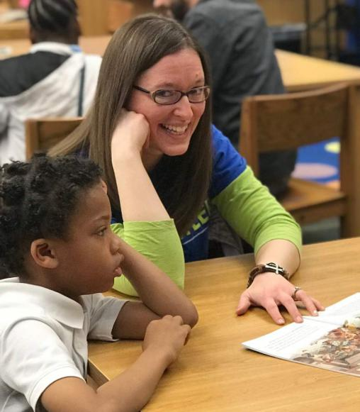 Woman reading to children at school.